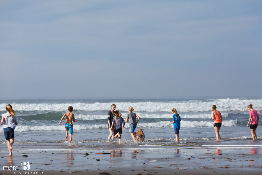 Oregon coast - kids at the beach - running in the waves