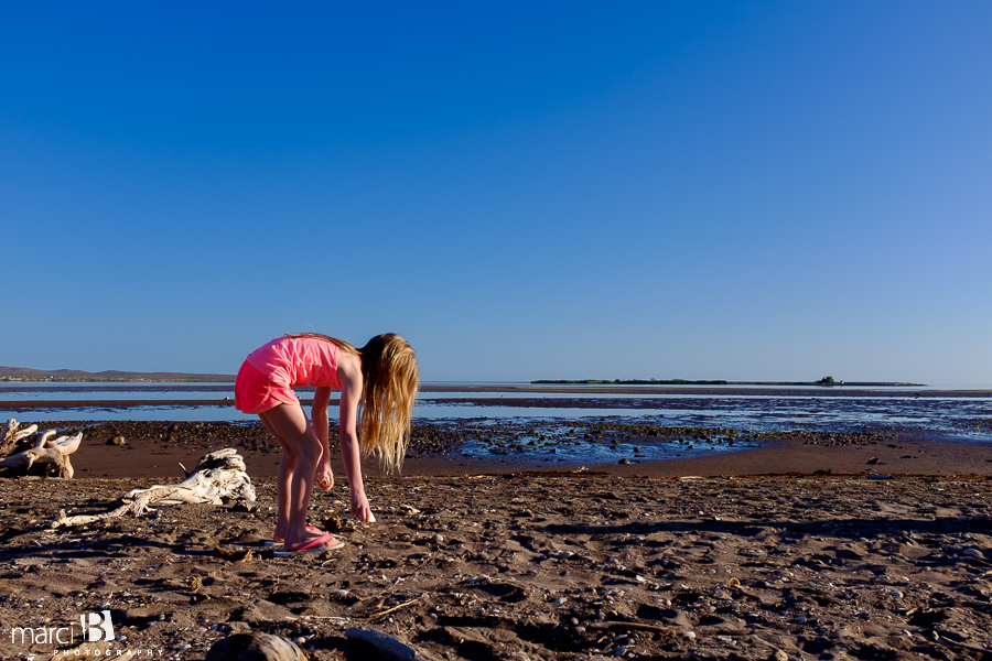 searching for shells - morning in Baja - girl on beach