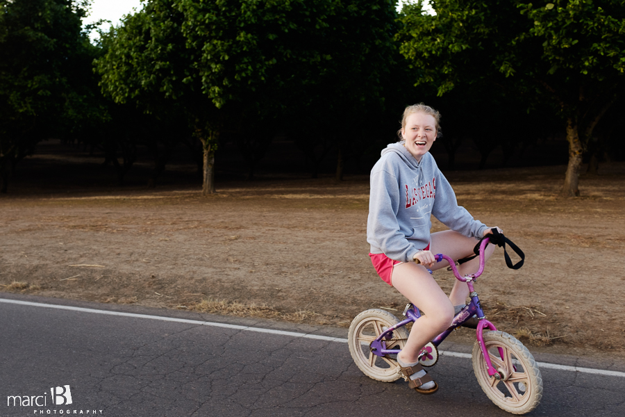 family bike rides - photo of teen on small bike - hazelnut orchard