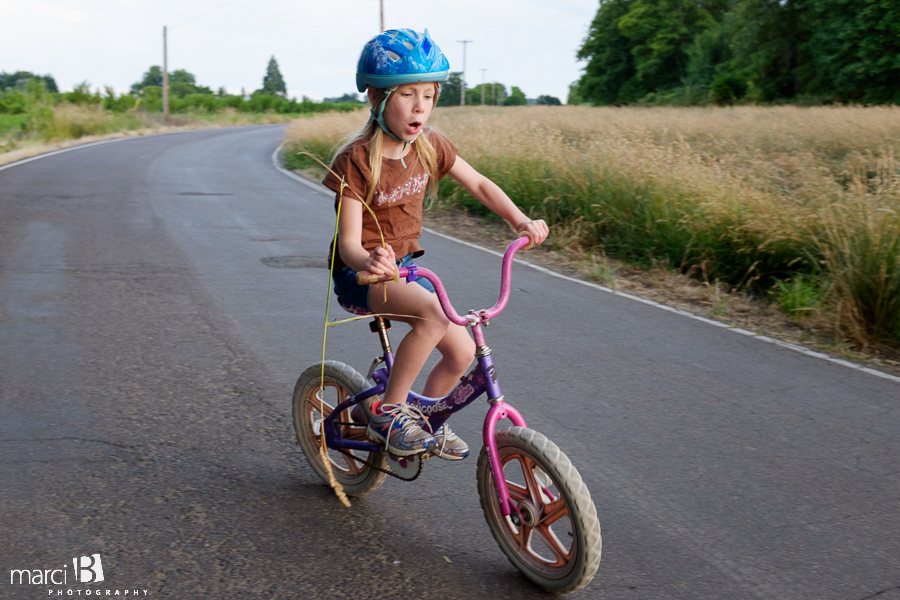 small girl on bike - country lane - candid photos - lifestyle photography