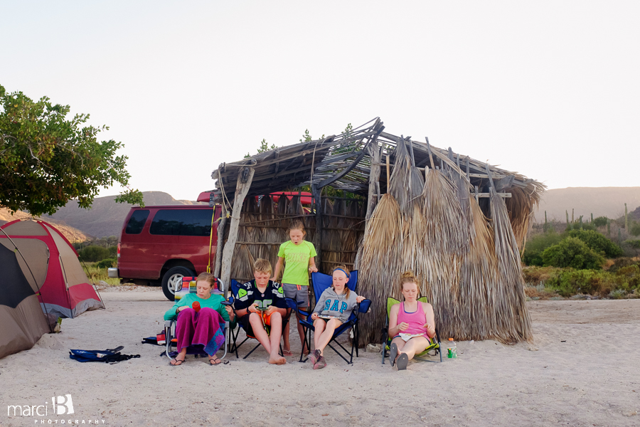 kids near palapa in Mexico - camping in Baja - family camp