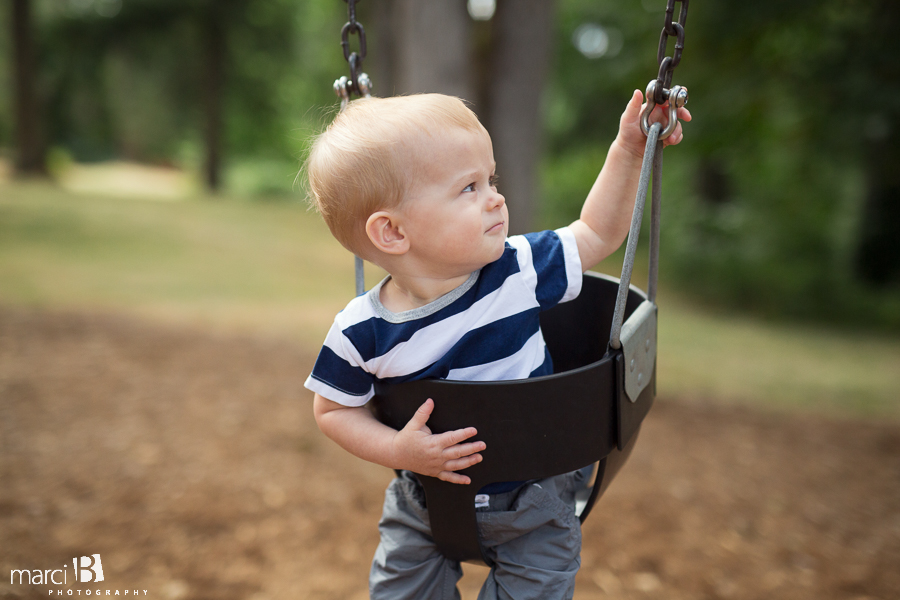 One year old photos - toddler in swing - boy in swing