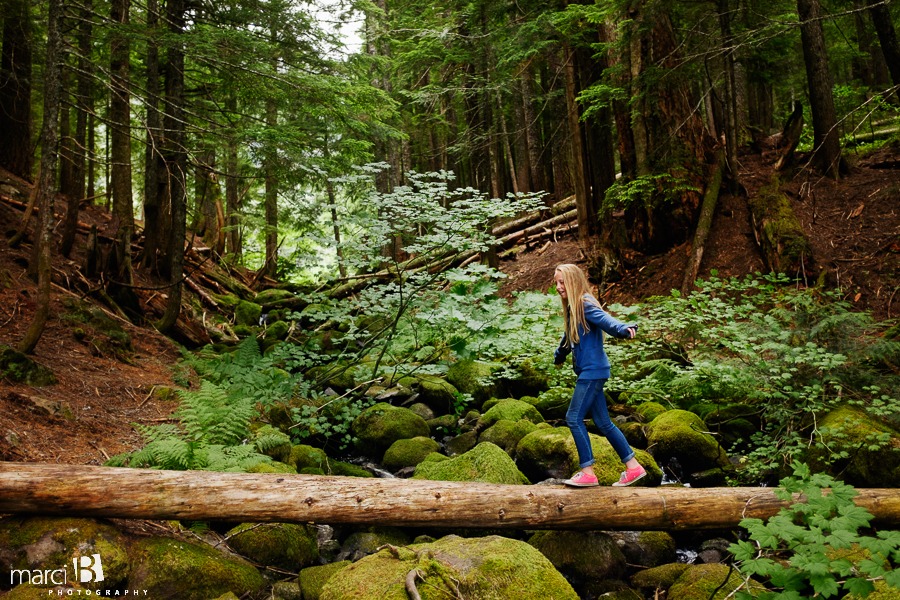 Camp photography - girl walking on log in woods