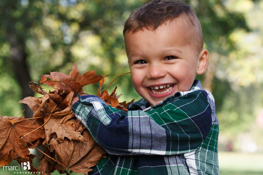 fall family photos - Corvallis photography - family photographer - photos of kids playing in leaves - boys in plaid - headshot